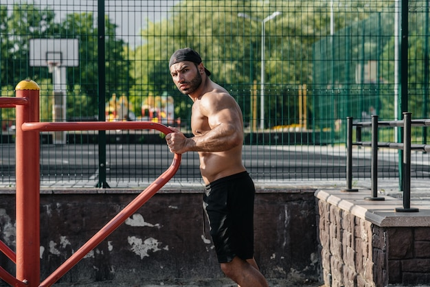 A fitness athlete trains on a sports field. healthy lifestyle
