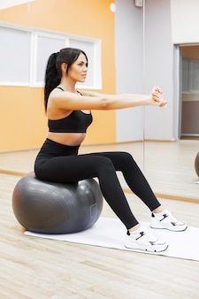 Fitness, beautiful woman smiling face enjoy work out with fit ball in fitness - sport and lifestyle concept.