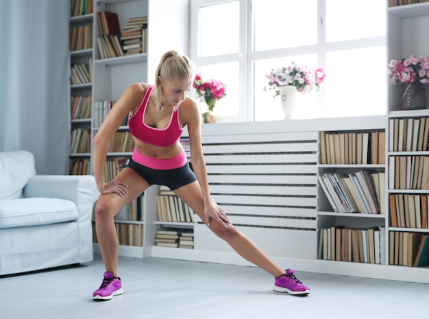 Fitness blonde woman workout at home