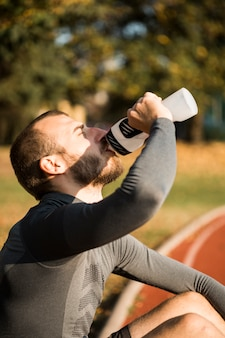 Fitness boy drinking water