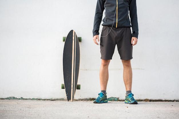 Fitness boy with skateboard