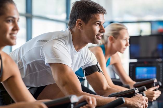 Fitness class biking at gym