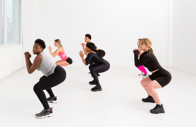 Fitness class with women on position