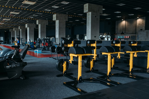 Fitness club interior. gym nobody. sport center equipment