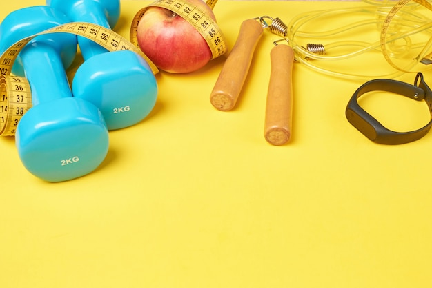 Fitness concept with blue dumbbells