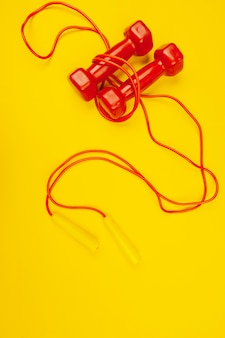 Fitness dumbbells on bright yellow