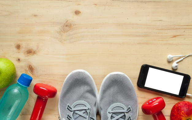 Fitness equipment consisting of dumbbells, training shoes and electrolyte drink