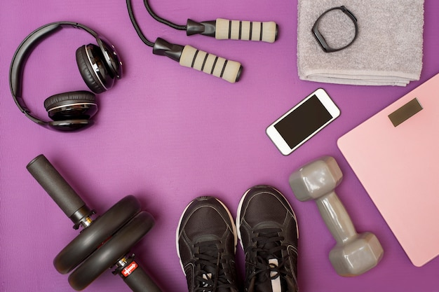 Fitness equipment on purple mat