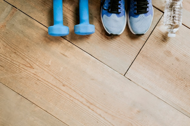 Fitness equipment on a wooden floor background