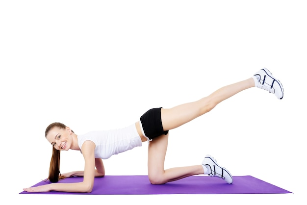 Fitness exercises for young women's body - isolated
