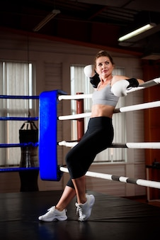 Fitness female getting ready for boxing practice.