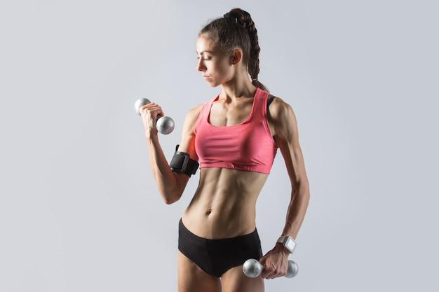Fitness girl doing weight training