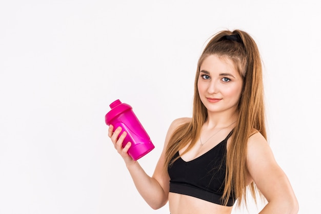 Fitness girl drinking water on white