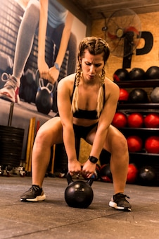 Fitness girl lifting weight