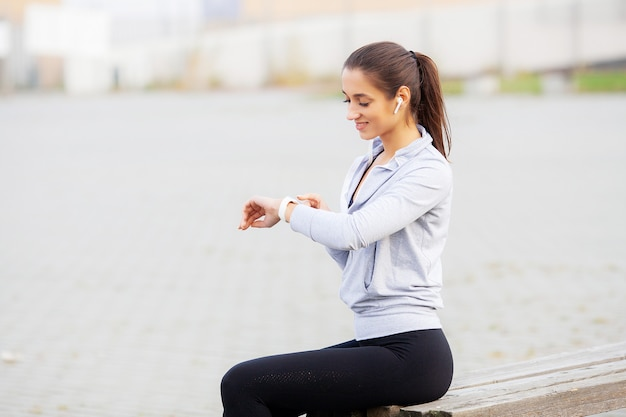 Fitness girl, portrait of a lovely young fitness girl listening music