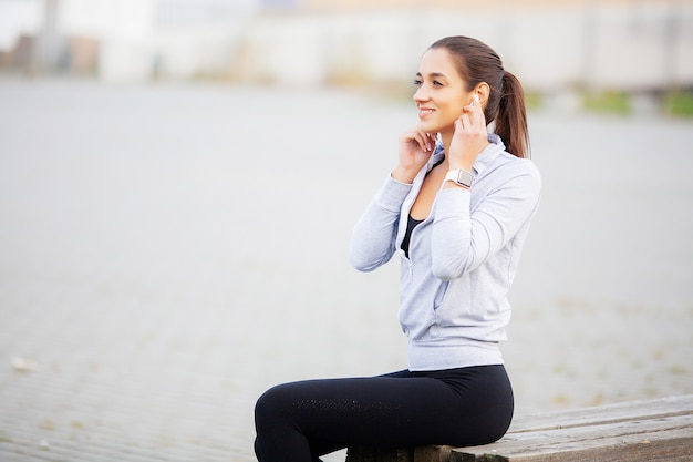 Fitness girl. portrait of a lovely young fitness girl listening music