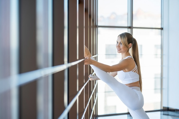 Fitness girl practicing twine