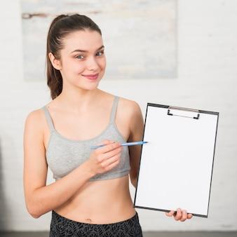 Fitness girl showing folder