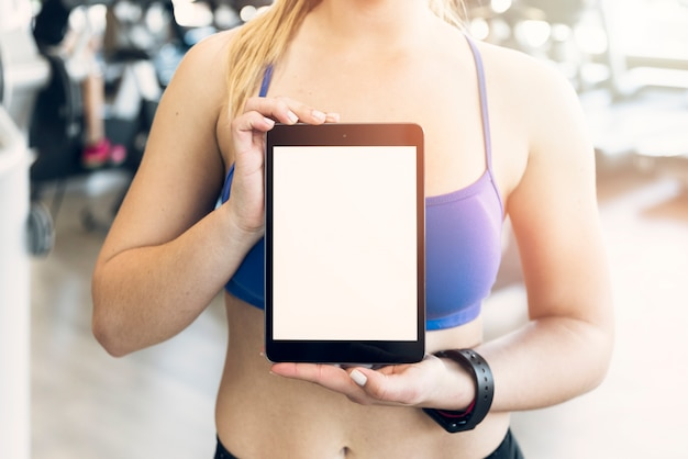 Fitness girl showing tablet