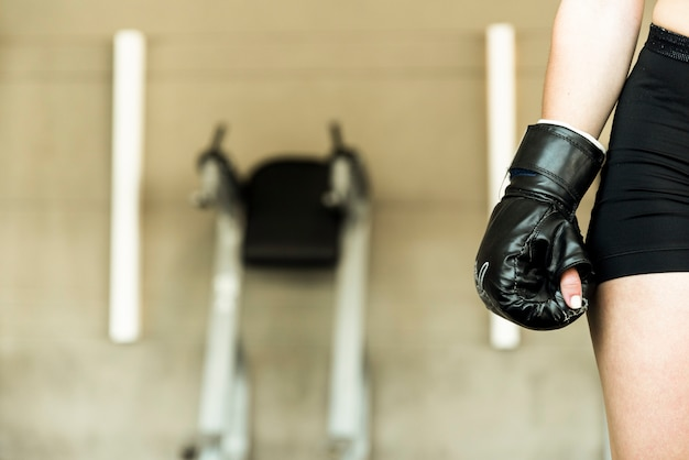 Fitness girl wearing boxing glove