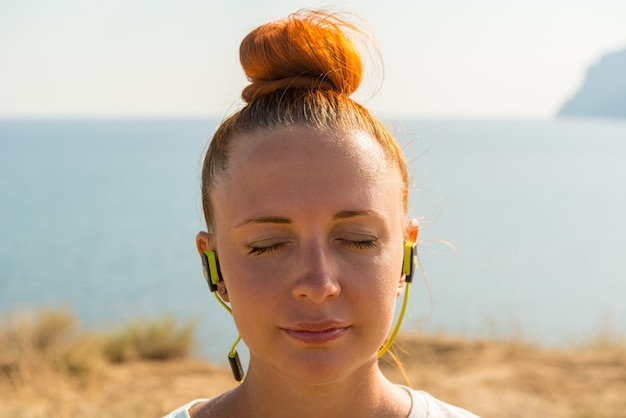 Fitness girl with wireless headphones