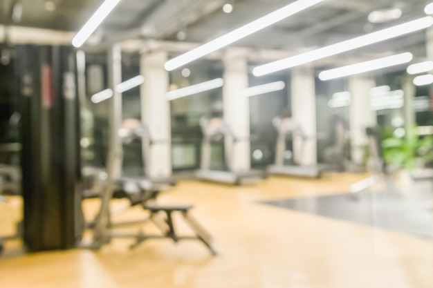 Fitness gym blurred for background of exercise equipments