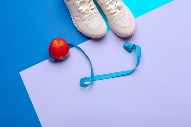 Fitness gym equipment on color background