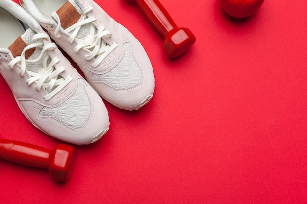 Fitness gym equipment on red