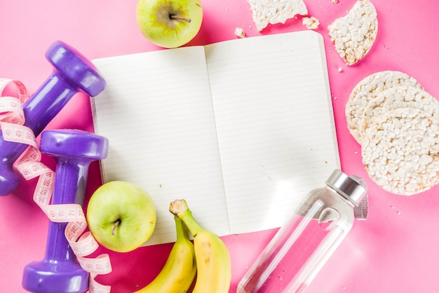 Fitness and healthy food on pink