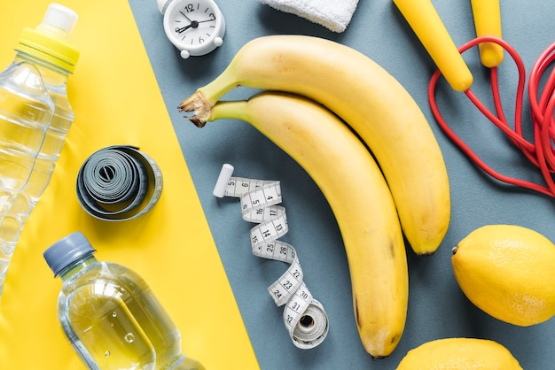 Fitness items composed on varicolored background