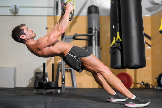 Fitness man doing functional training at gym