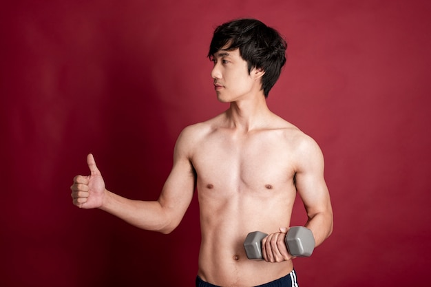 Fitness man on red background
