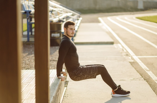 Fitness man training outdoors, living active healthy