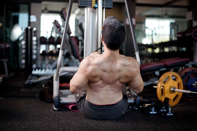 A fitness man work out in the gym