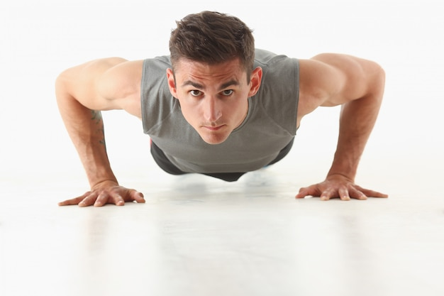 Fitness man wringing from the floor