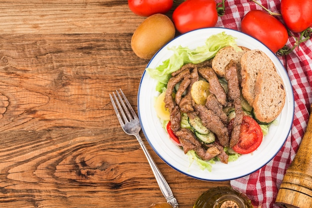 Fitness meal beef and vegetable salad