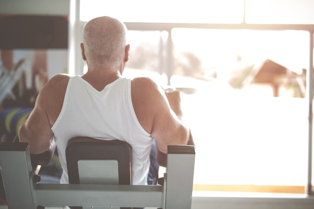 Fitness old man health exercise at gym. healthy workout concepts.