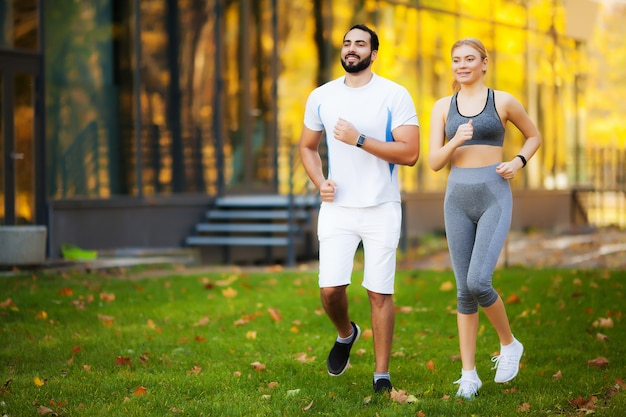 Fitness. personal trainer takes notes while woman exercising outdoor