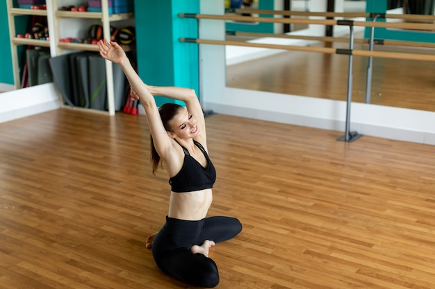 Fitness, sport and healthy lifestyle concept - woman doing yoga exercise at studio.