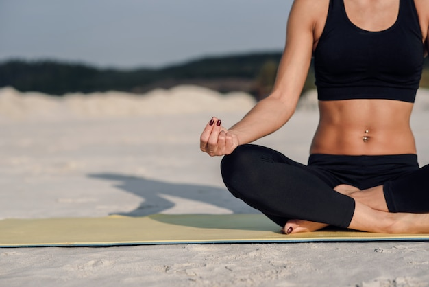 Fitness sport yoga and healthy lifestyle concept. close up portrait of beautiful girl meditating in easy sitting position