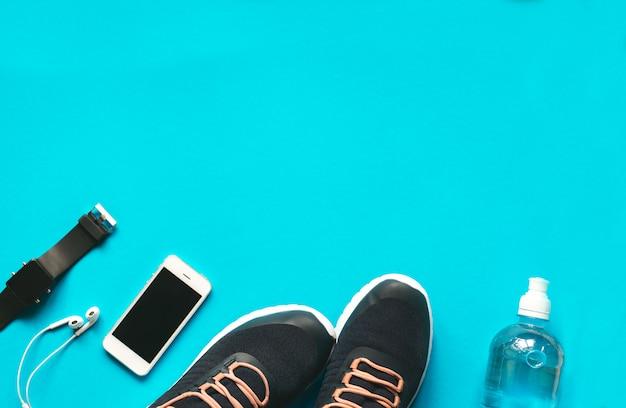 フィットネススポーツ用品と青色の背景にアクセサリー