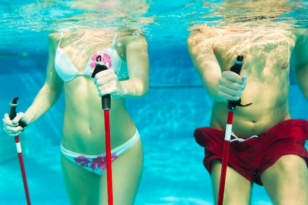 Fitness - sports and gymnastics under water in swimming pool or spa