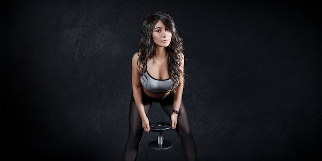 Fitness sports woman trains