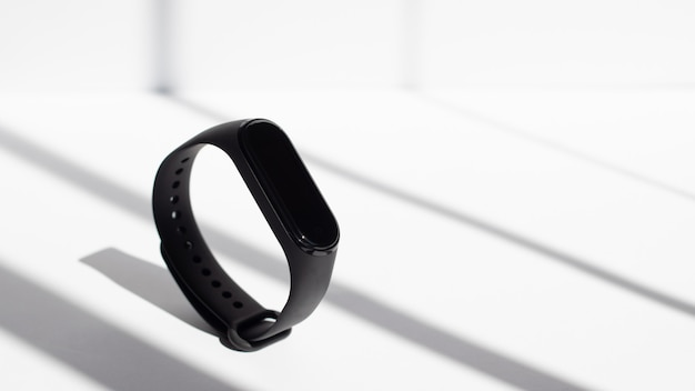 Fitness tracker on a white background the rays of the morning sun