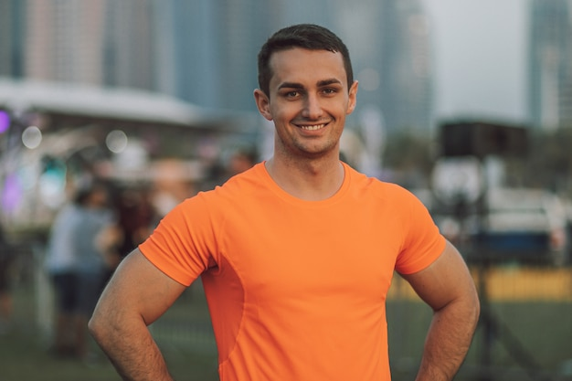 Fitness trainer smiling outdoor