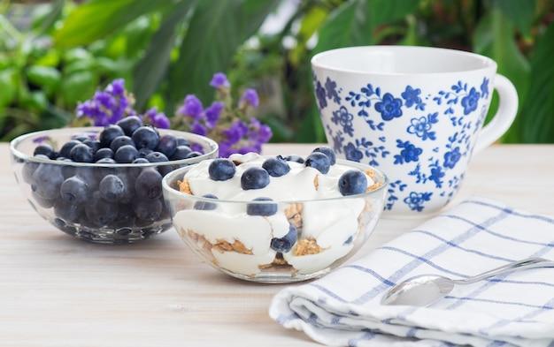 Fitness wheat muesli with yogurt, blackberry and tea