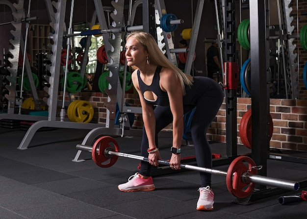 Fitness woman doing deadlift exercise in gym