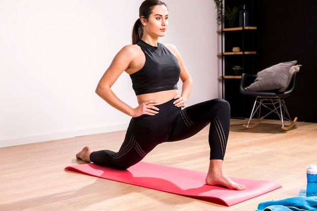 Fitness woman doing exercise at home