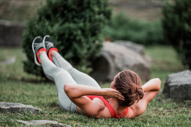 Fitness woman doing exercise outdoors in park