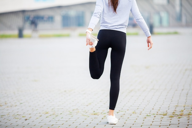 Fitness. woman doing stretching exercise on stadium
